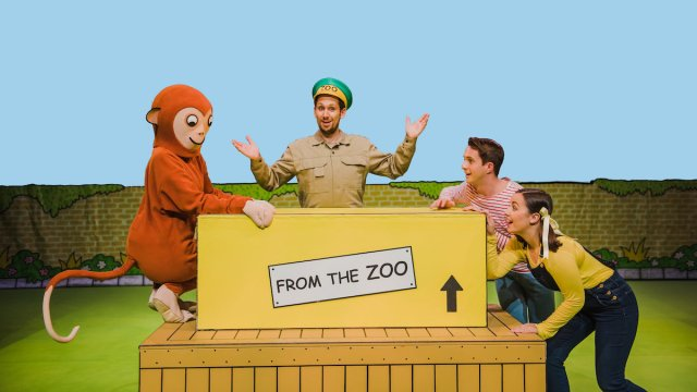 An actor dressed as a monkey, an actor dressed as a zookeeper and two actors dressed as children on the set of theatre show Dear Zoo