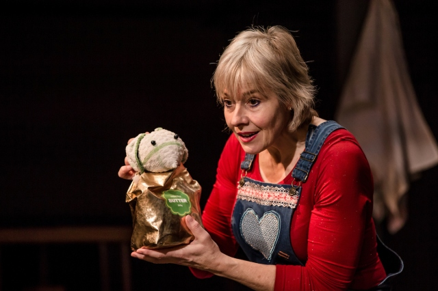 An actor holds a puppet mouse
