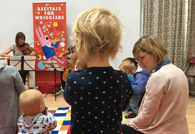 A toddler and some babies listen to a classical concert at the Edinburgh Festival Fringe